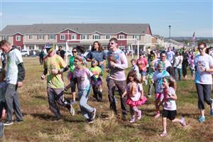 Families running at our Color run.